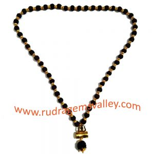 Black rudraksha 5 face 8.5mm beads mala with gold plated metal caps-trishul-pendant, you may put yantra under damaru (it is enabled with screw to put yantra in it) total 55 beads in it, length (circumference) 27 inches.