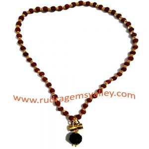 Rudraksha 5 face 8.5mm beads mala with gold plated metal caps-trishul-pendant, you may put yantra under damaru (it is enabled with screw to put yantra in it) total 55 beads in it, length (circumference) 27 inches.