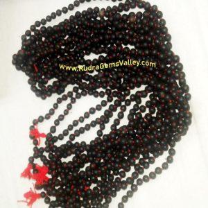 Black Vaijayanti Wood Beads-Seeds String (mala of 108 vaijayanti 6-7mm beads + 1 rudraksha 16mm beads), pack of 1 string.