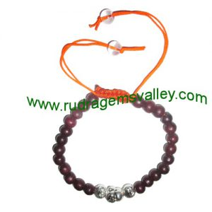 Adjustable beaded free size 7mm red wood beads bracelets, made of 7mm red wood 24 beads and 3 budhha metal beads in thread as per picture. Pack of 1 piece, also available in custom designs and sizes as per your instructions.